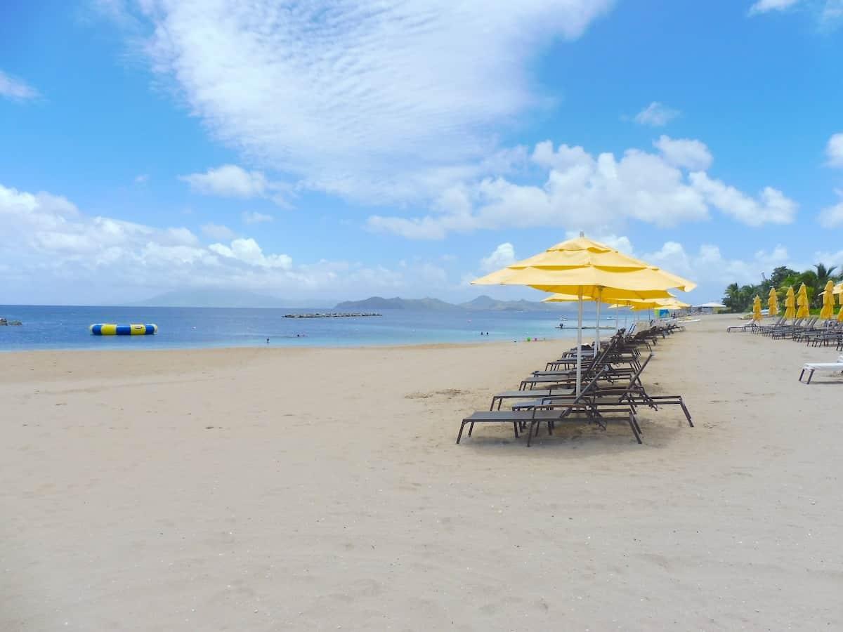 Loungers on Pinney's Beach in Nevis.