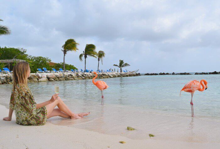 Travel writer Caitlin Martin enjoying a Renaissance Island Aruba Day Pass with a glass of champagne