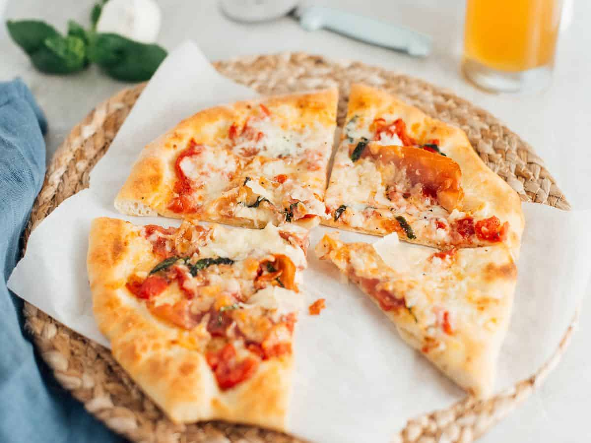 A baked pizza featuring beer pizza dough and toppings.