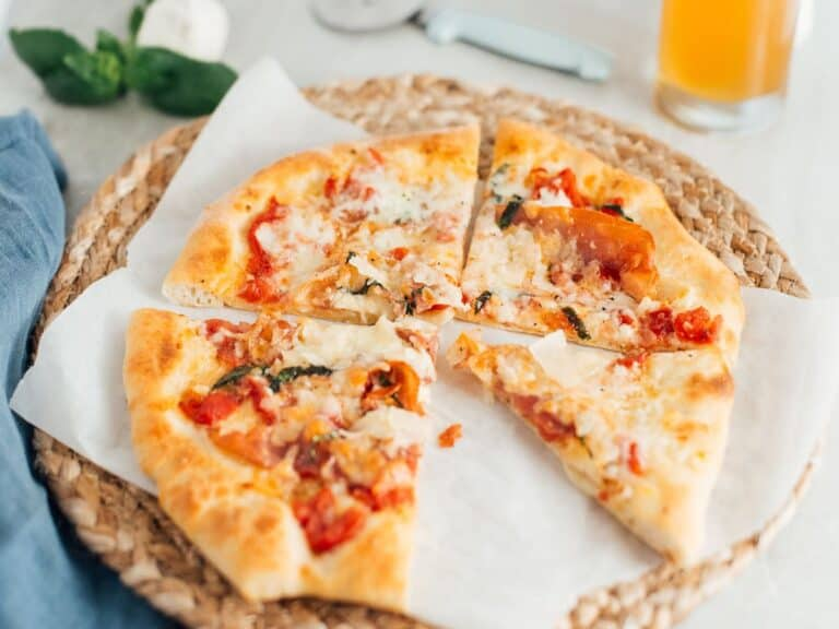 A brie, prosciutto and basil pizza made with beer pizza dough.