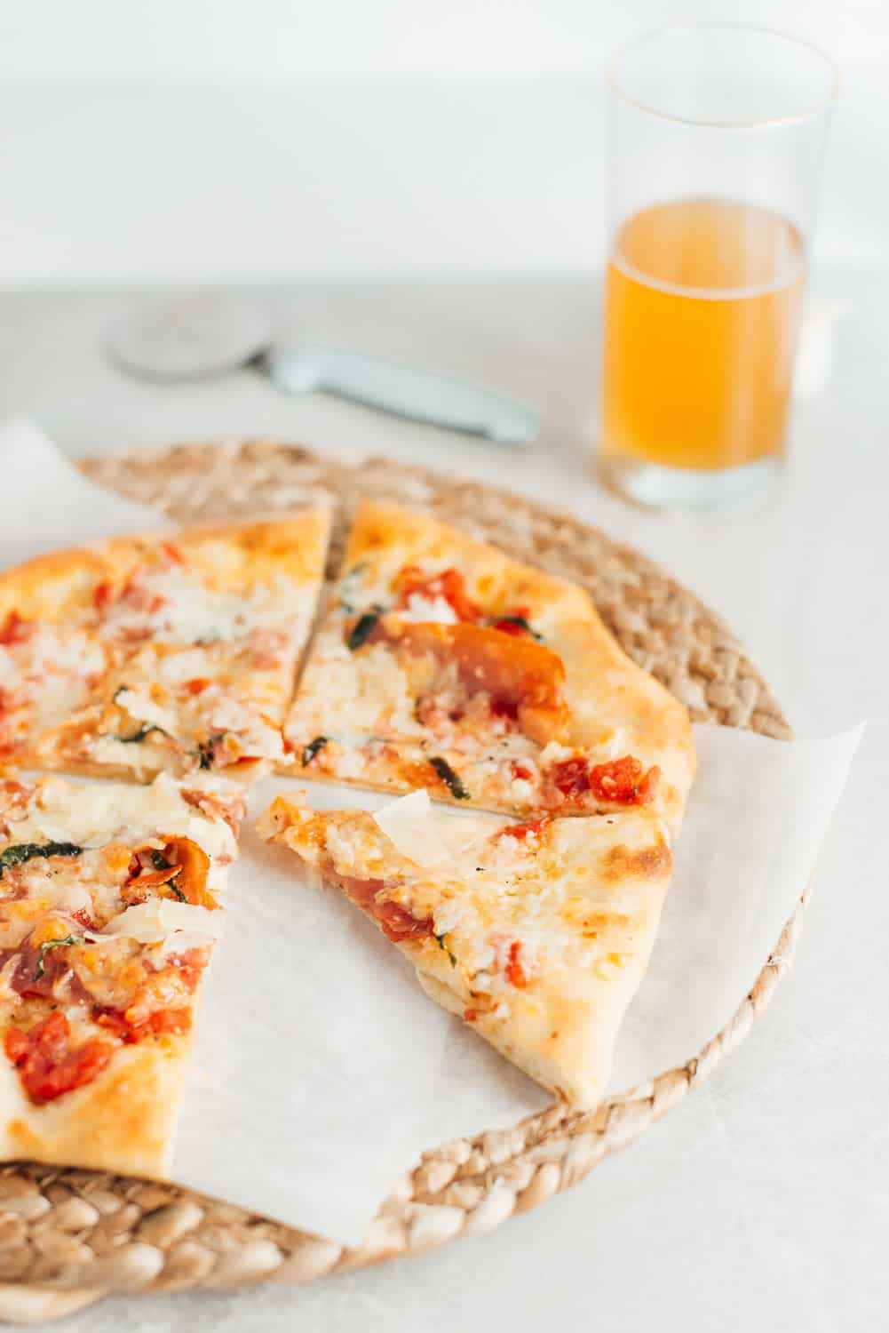 Easy homemade pizza with a glass of beer.