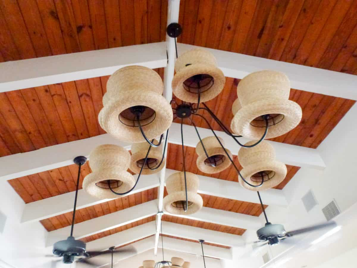 Straw hats on a light fixture as decor at Straw Hat Restaurant on Anguilla.