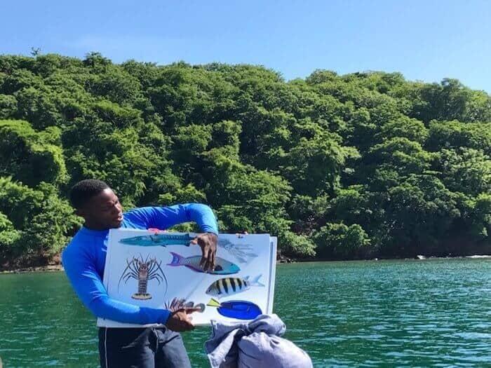 Guide Kimmie of Seafaris Adventure tour shows participants the marine life at Underwater Sculpture Park