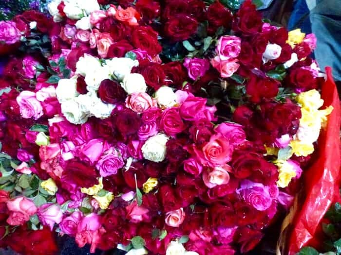 red, pink and white roses in the Benito Juarez Mercado in Puerto Escondido Mexico.