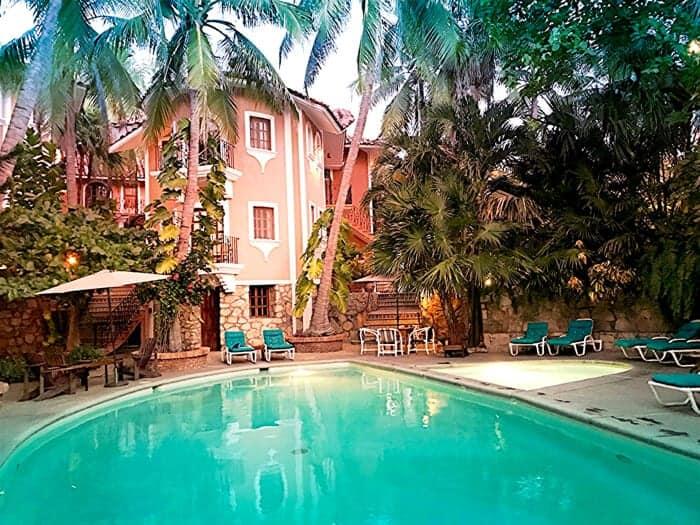 Swimming pool and lush greenery at Santa Fe Hotel in Puerto Escondido Mexico.