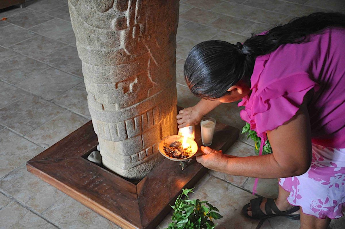Woman making an offering in Tututepec, Mexico.
