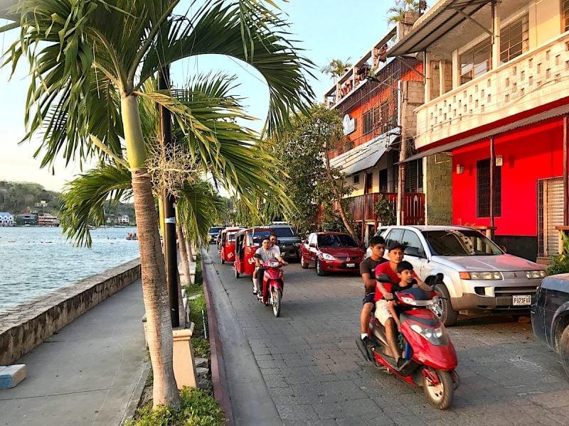 Street scene of tuk tuks in Flores, Guatemala.