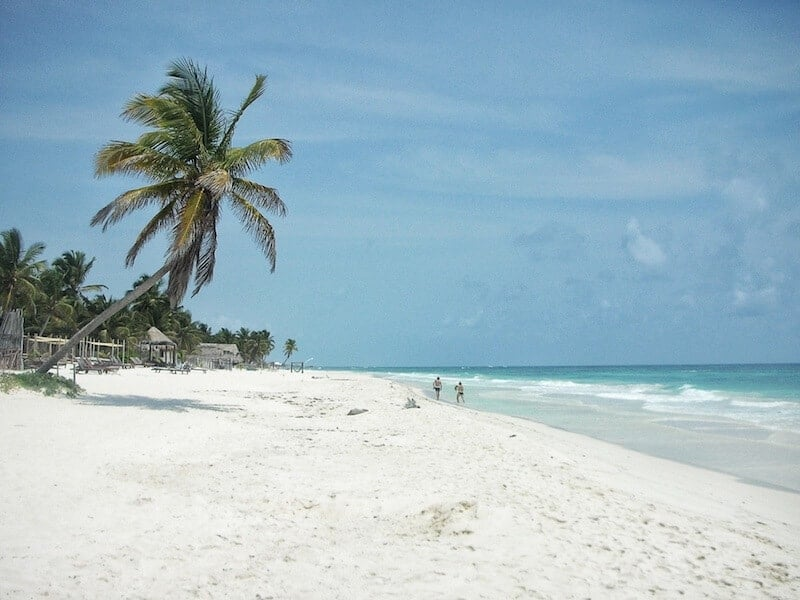 View of the white sand beach at Azucar Tulum.