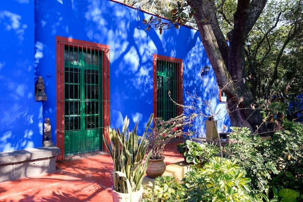 Colorful courtyard at the Frida Kahlo Museum in Mexico City.
