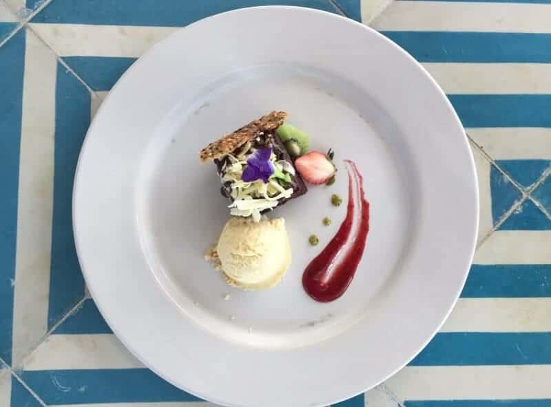 Romantic dessert of ice cream with flowers while dining at Villa Premiere Puerto Vallarta restaurant.