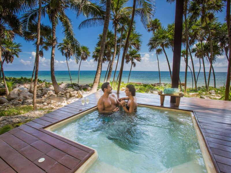 Couple in a plunge pool at Mi Amor hotel in Tulum Mexico.