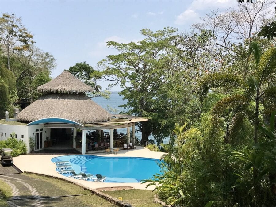 Swimming pool and restaurant at Bolontiku Resort in Guatemala.
