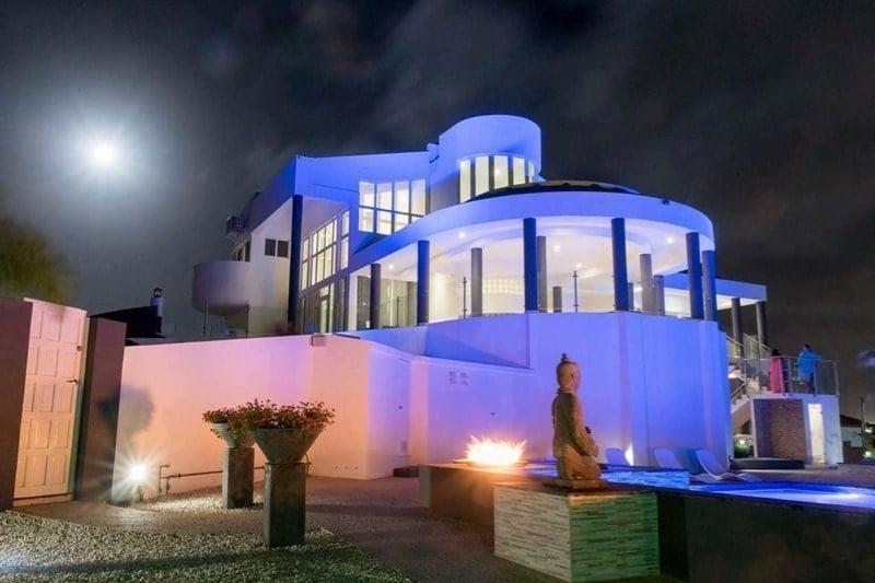 Purple lights illuminate Aruba Villa Royale in Aruba. Credit: Villa Royale Aruba
