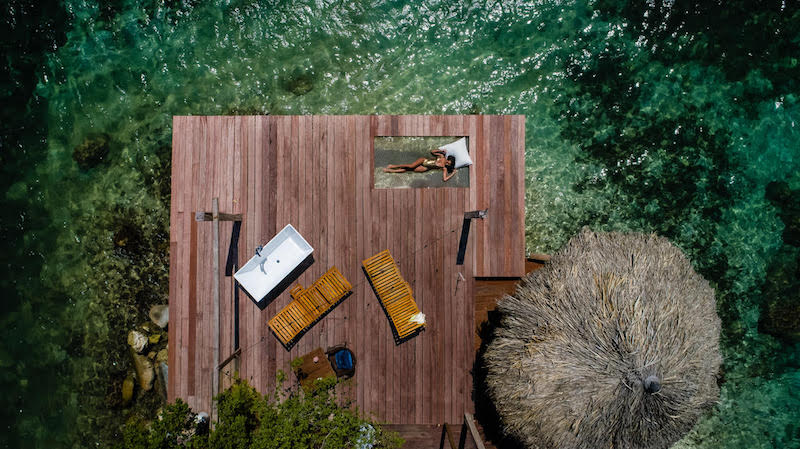 Drone view of a deck and the Caribbean at Isla Alistaire a boutique villa in Aruba. Credit AOV