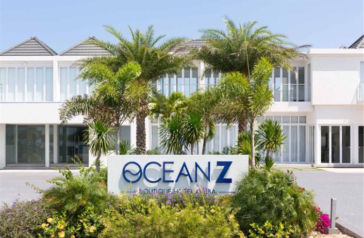 Palm trees in from of Ocean Z Hotel a luxury boutique hotel in Aruba. Credit Sue Campbell.