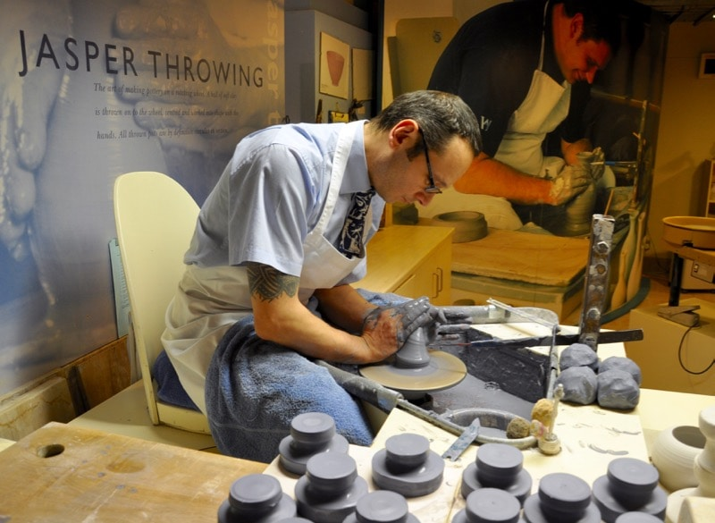 Artisan shaping a piece of pottery while Jasperware throwing at Wedgwood World.