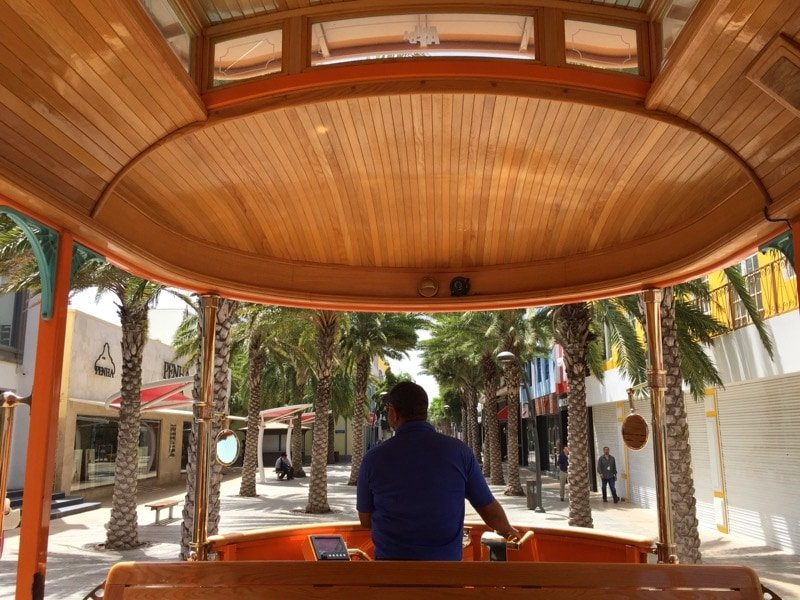 Hop on the free trolley to explore the restaurants in downtown Oranjestad Aruba