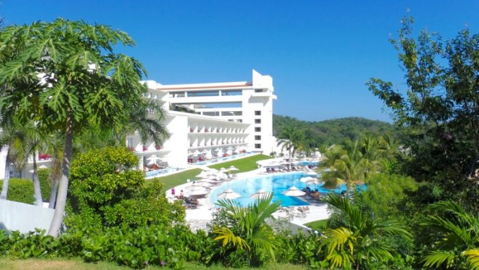 View of swim-out suites in Building 5 from Castaways restaurant Secrets Huatulco
