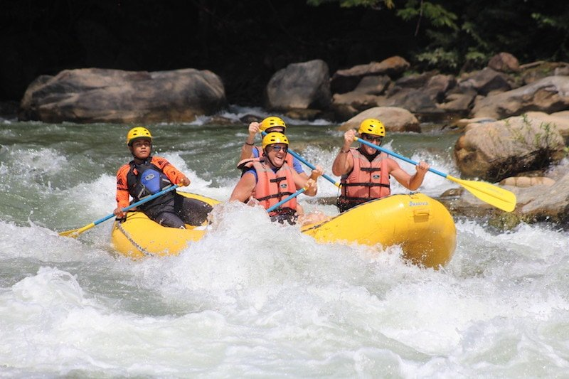 A group of men whitewater rafting one of the top things to do in Mazunte on a Huatulco Excursion. Credit: Aventura Mundo.