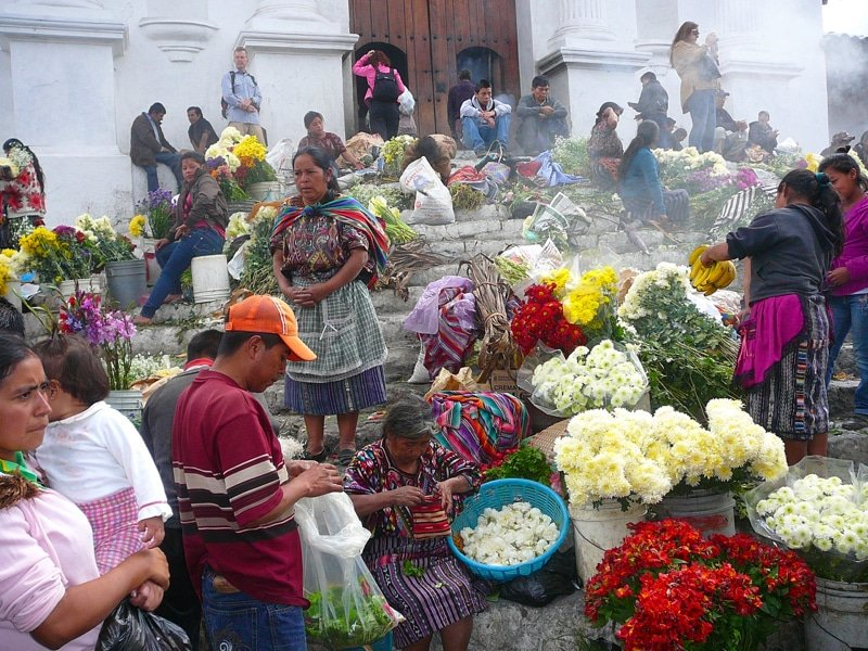 Flowers and vendors on the steps of the church in the K'iche' Mayan town of Chichicastenango, Guatemala.