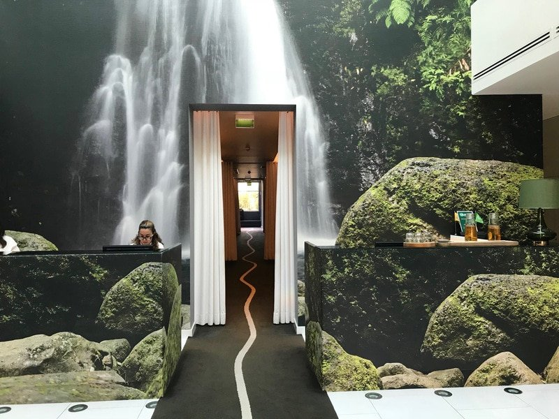 Modern lobby of Furnas Boutique Hotel where thermal waters and a spa await in the Azores