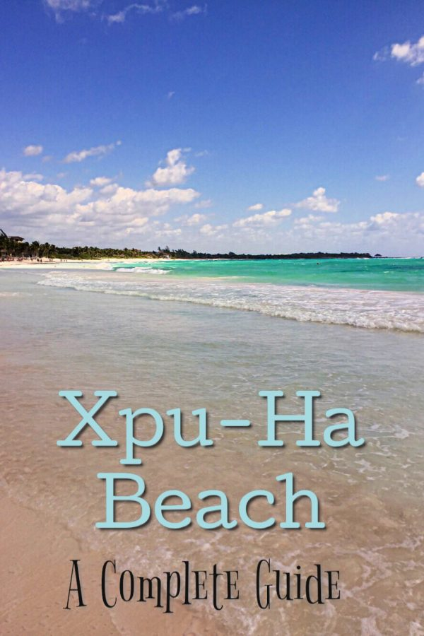 Sand and blue waters with text overlap of Xpu-Ha Beach