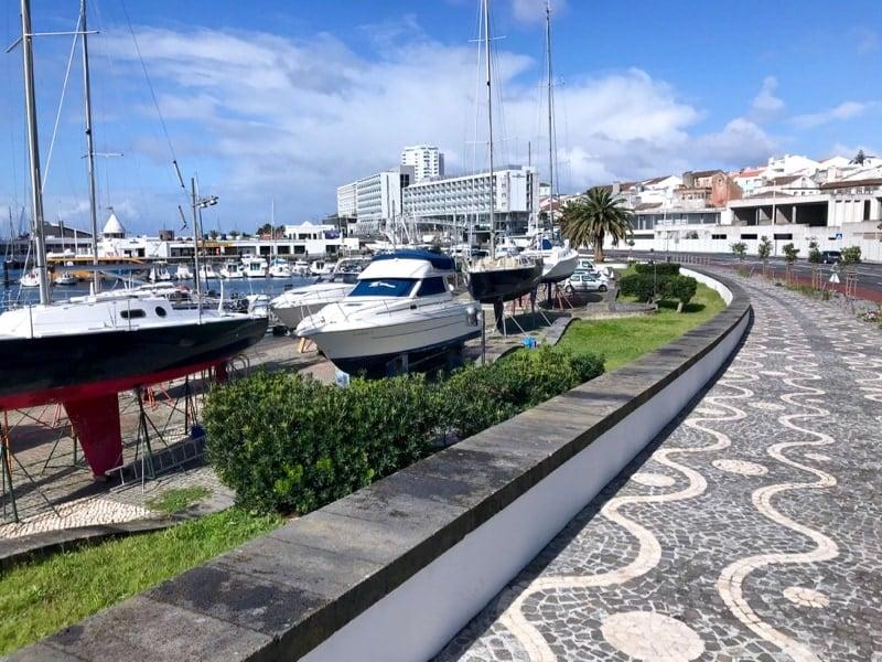 Pretty calçada portuguesa (Portuguese cobblestone pavement mosaics) along Ponta Delgada's marina promenade