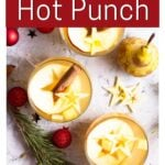 Mugs of hot fruit punch with text overlay for Pinterest of Christmas Hot Fruit Punch. for