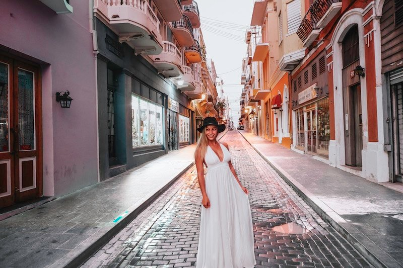 Woman in white dress on the cobblestone streets Old San Juan in Puerto Rico Itinerary.