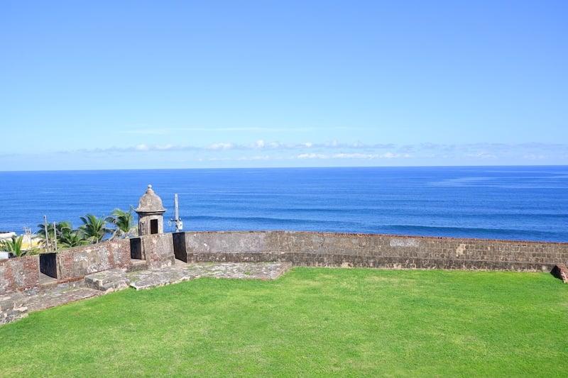 Fort El Morro overlooking the ocean with green grass in Puerto Rico.