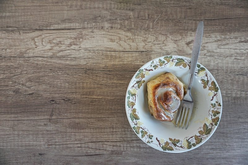 A homemade cinnamon roll made in a pie tin and no measuring spoons in Switzerland: