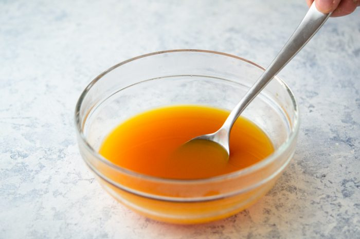Mix gelatin into mango juice for Mango Pie