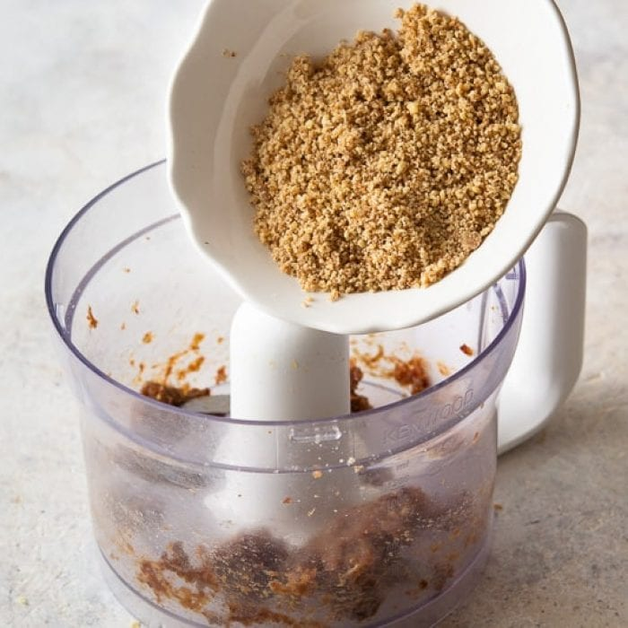 Blend the Medjool dates with walnuts in a food processor