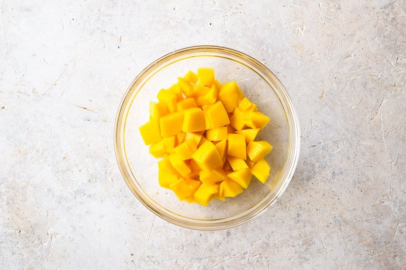 Chopped fresh mango for Coconut Mango Panna Cotta