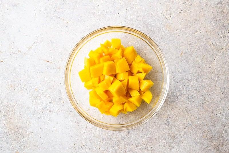 Chopped fresh mango for Coconut Mango Panna Cotta