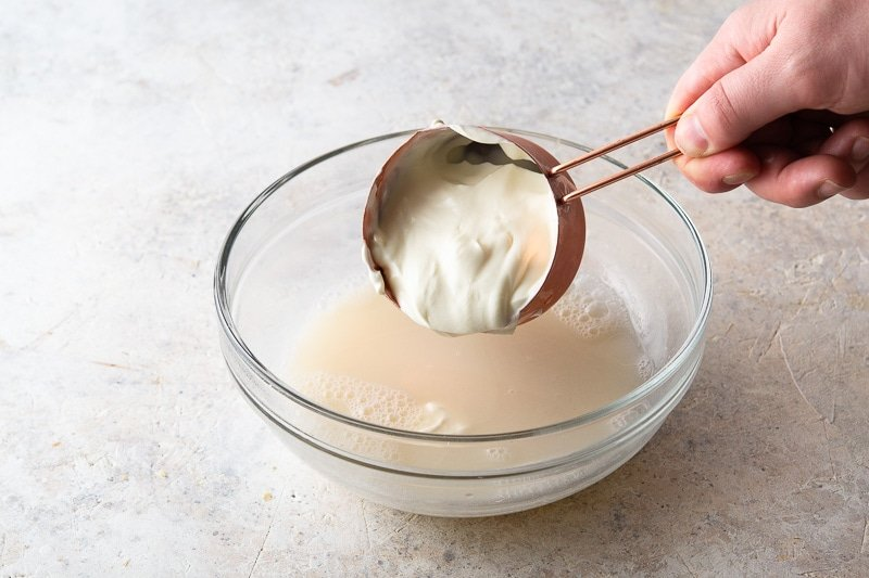 Mix the Greek yogurt and milk with the strained solids and gelatin