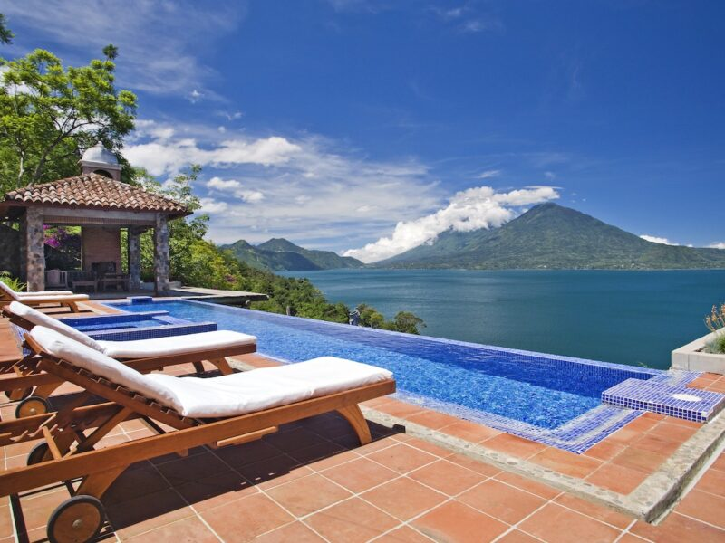 Two lounge chairs overlooking the infinity pool at Casa Polopo in Guatemala.