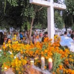 Marigolds and candles at a cemetery on Day of the Dead in Puerto Escondido, Mexico.