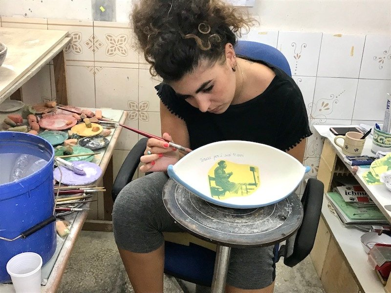 Painting ceramics at La Bottega in Puglia