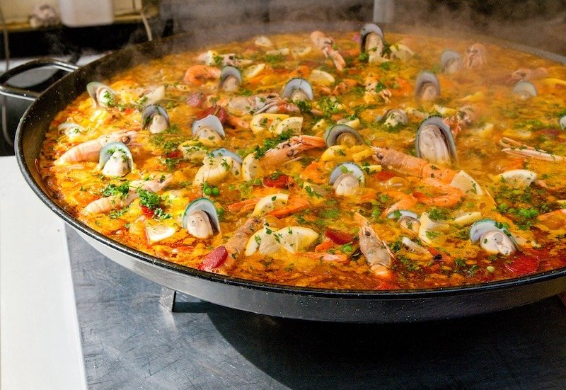 closeup of paella simmering in a pan