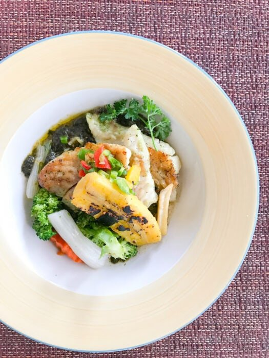 Menu at Spice Island Beach Resort includes seared snapper with callaloo puree and grilled plantain on a plate