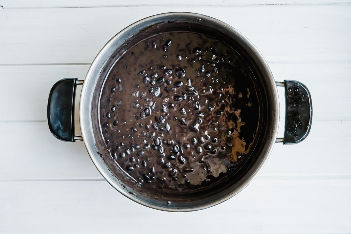 Cooked black beans in a pot.