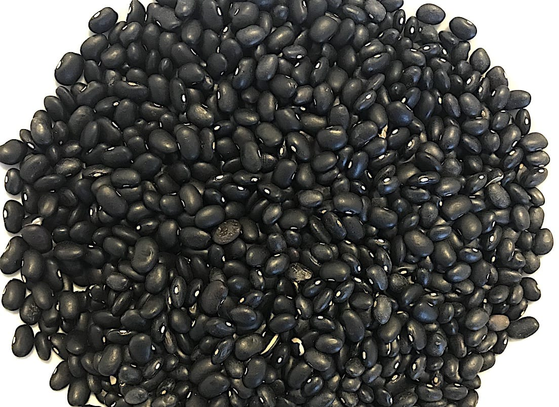 Black Turtle Beans Phaseolus vulgaris on a white table.