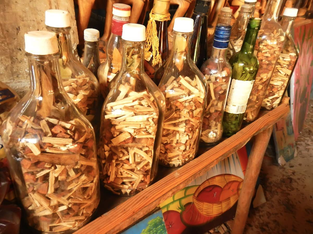 Display of bottles containing Mama Juana root, spice and bark mixture.