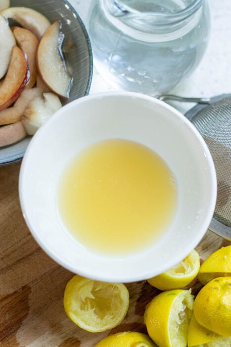 Fresh lemon juice in a white bowl.