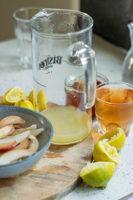Add ingredients of bourbon punch to a glass pitcher.