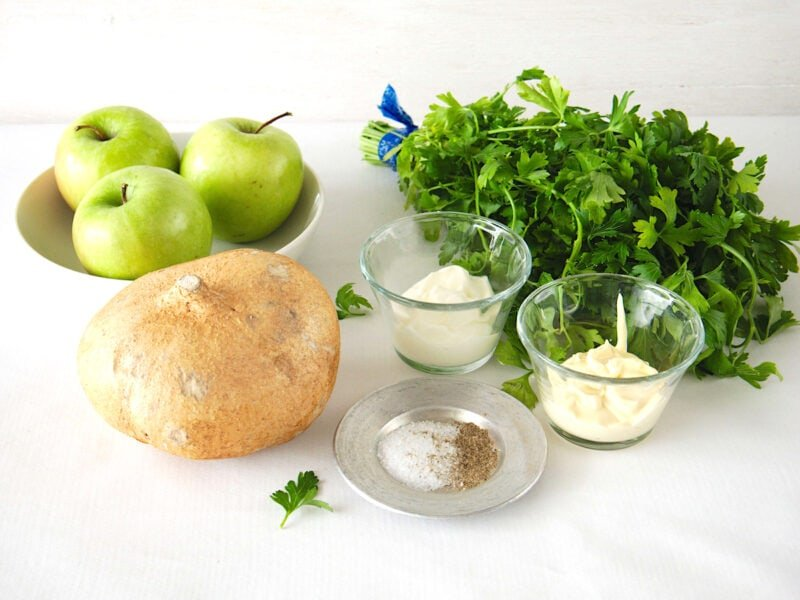 Ingredients for grated jicama salad include green apple, mayonnaise, Mexican crema, parsley and jicama. .