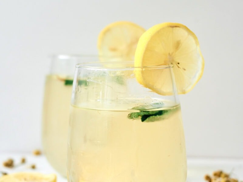 two glasses of chamomile iced tea with lemon and mint