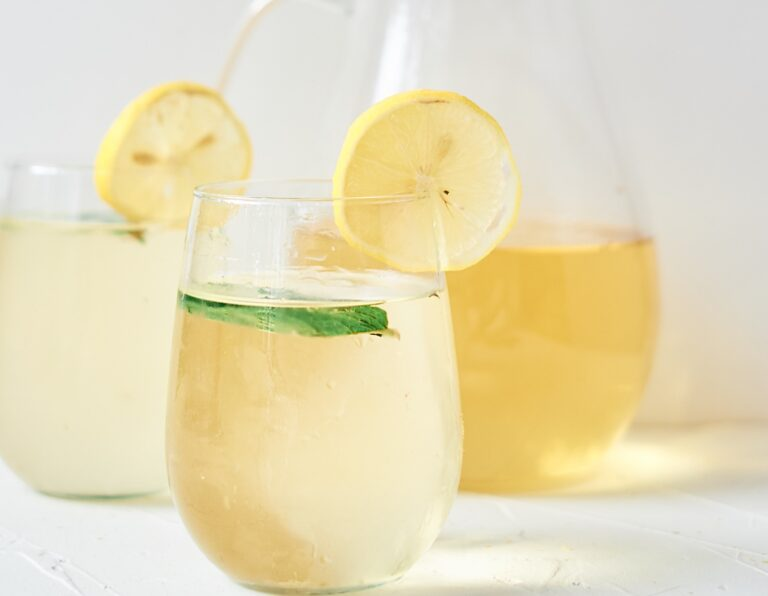 fresh chamomile iced tea garnished with lemon and mint