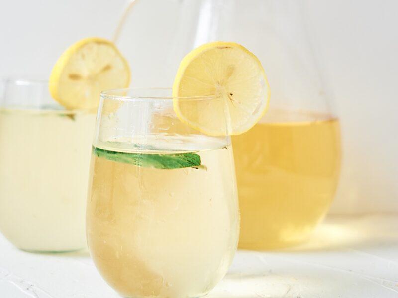 fresh chamomile iced tea garnished with lemon and mint